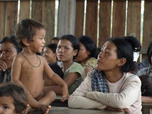 Woman and child in community meeting, Cambodia
